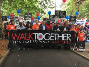 Walking with the other speakers at the Walk Together March