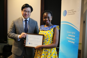 Dr Soutphommasane awarding essay prize winner Kupa Matangira